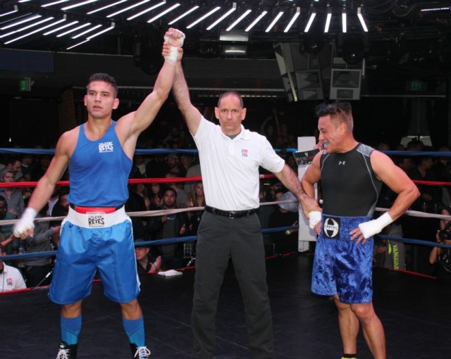 At the conclusion of Bout #6, referee Dana Kaplan is shown raising the arm of the victorious Hector Gomez (l) who earned the stoppage victory over Raphael Delaquia.