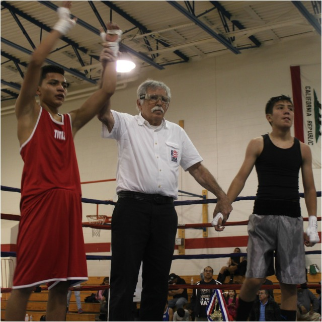 At the conclusion of Bout #5, we see veteran referee Will White raised the arm of the victorious