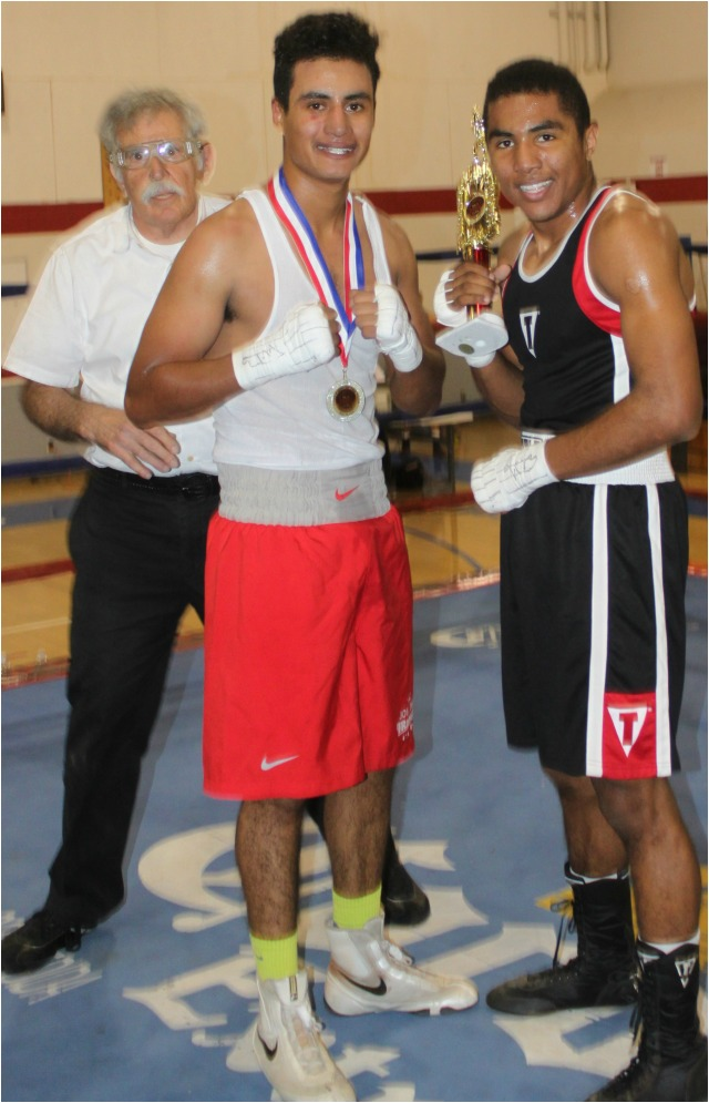 At the conclusion of Bout #6, the victorious Lucio Hirales (r) and his defeated opponent Juan Rangel