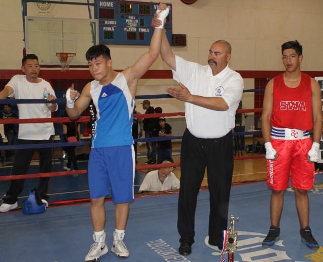 At the conclusion of Bout #8, we see referee Hondo Fontan raising the arm of the victorious Brandon Lee.