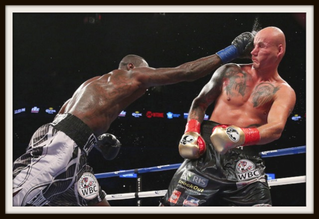 Here we see the WBC World Heavyweight Champion Deontay Wilder (l) punishing Artur Szpilka with another punch to the face. Even though it happened a lot, the tough Artur Szpilka seemed indestructible.