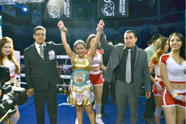 "Guadalupe ""Lupita"" Martinez defended her WBC Silver super-flyweight belt for the first time with an unanimous decision victory over Celeste Belem ""Muneca"" Gonzalez in Mexico City on February 29, 2016."