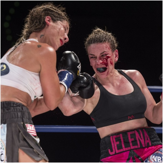 (l to r) Edith Soledad Matthysse and the bloodied Jelena Mrdjenovich exchange punches in the 10th and final round of their WBC & WBA World featherweight title fight.