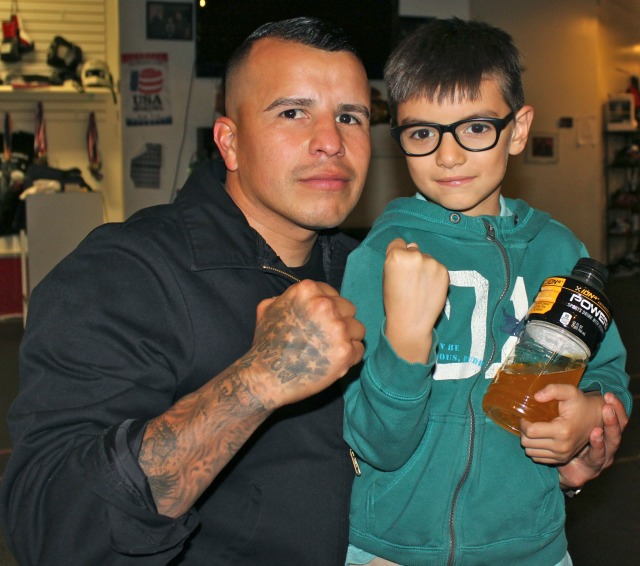 Coach Salvador of the Bound Boxing Academy is joined by a future pugilist.