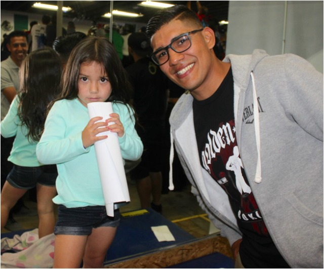 Top ranked welterweight Antonio Orozco who trains at the House of Boxing and is also a parent of three adorable children is shown joking around with this young lady Aaliyah Bailon. Photos: Jim Wyatt