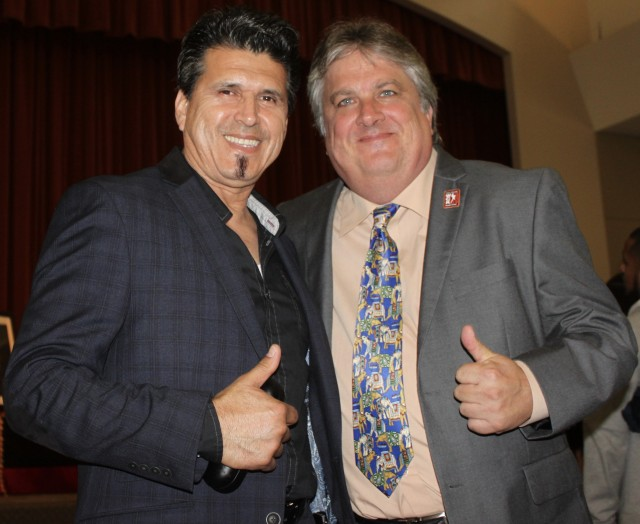 """Dennis Warner (r) shown here with judge Luis Cobian, one of the many BFF, mentioned how he and Chaney could go anywhere in the world and people at an airport would be coming up to them and saying, """"Master Chaney, do you remember me, I used to be one of your students?"""" He was always introducing me to someone, everyone. At this one hotel in Las Vegas, they said they might not be able to find us a room. The next thing I know, there's a valet or bellhop coming over to the desk and telling the clerk that he knows Master Chaney and to take care of us. As a consequence,we were given an upgrade to their Penthouse suite at no extra charge. Then, before leaving the lobby, they're handing me two coupons for a free lobster dinner. His former students never forgot him. They were everywhere and they'd always come running over to him."""""""