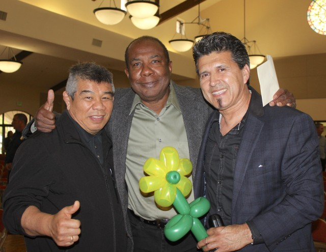 Cecil Peoples (c) has his photo taken with Muay Thai judge Luis Cobian and referee Rex Ajarn. Peoples said he was indebted to his best friend who got him started