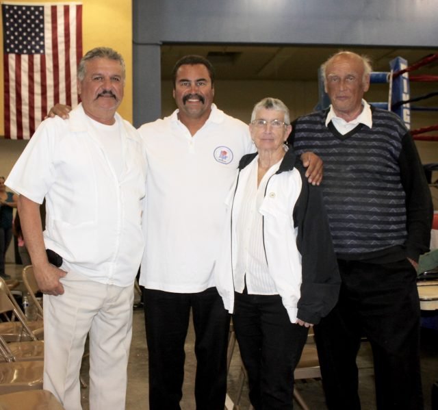 A few of the outstanding volunteer men and women who make the USA Amateur Boxing program work (l to r) Dr. Arturo Garcia Iniguez, USA Amateur Boxing's LBC 44 CAL Border President Hondo Fontan, official timekeeper Melanie Ley, and the head of officials Willie Kuhn.