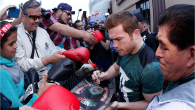 "Saul ""Canelo"" Alvarez barely gets out of his car and he is swamped by autograph seekers outside the House of Boxing Gym inParadise Hill, San Diego, Calif."