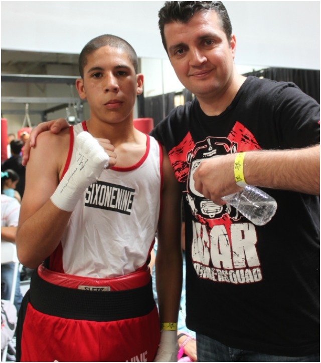 At the conclusion of his match versus Andrew Sandoval, one of Sanchez's coaches Jack Ballo approached to have his photo taken with his protege Carlos Sanchez.