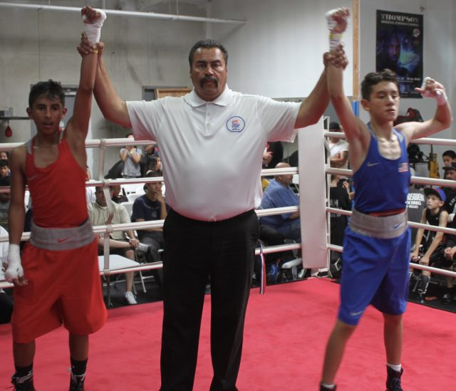 At the conclusion of Bout #10, we see referee Hondo Fontane raising the arms of the combatants, Anthony Perales (l) and Fernando Diaz (r). All photos: Jim Wyatt