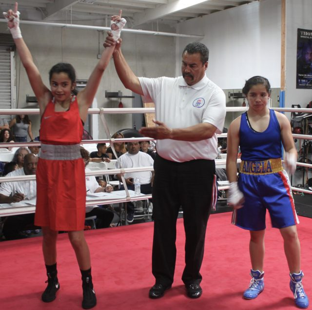After the announcer disclosed the winner, referee Hondo Fontane raises the arm of the victorious Destiny Diaz who was representing LBC 49 in Nevada.