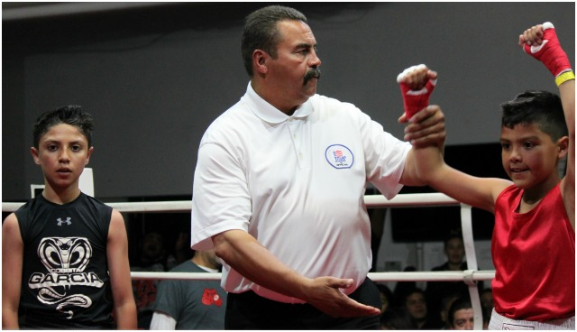 At the conclusion of Bout #7, referee Hondo Fontane raises the armof the victorious JanCarlo Meza.