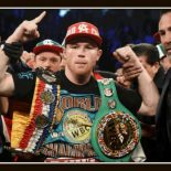 """After the demolition of Amir Khan on Saturday night at the new T-Mobile Stadium in Las Vegas, Saul """"Canelo"""" Alvarez has his arm raised in victory by his promoter Oscar De La Hoya."""