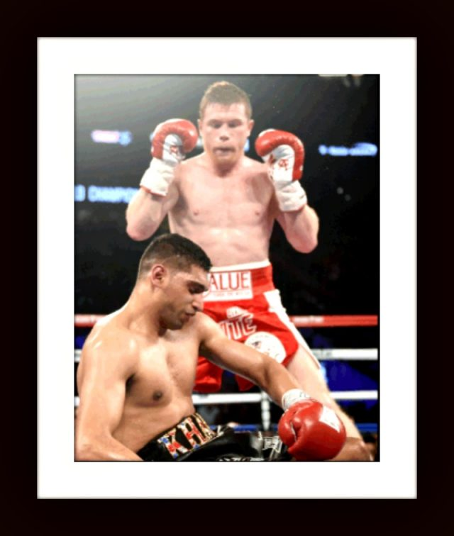 "Saul ""Canelo"" Alvarez stands over his fallen opponent Amir ""King"" Khan, ""Good night now."""