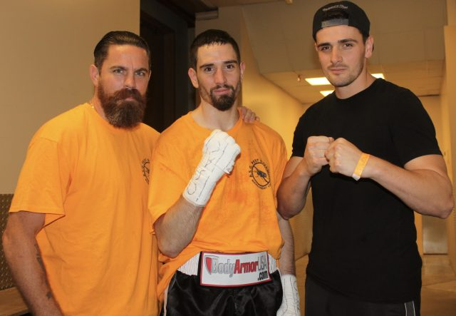 After seeing the fight doctor, Skender Halili graciously poses for a photo with his mates.