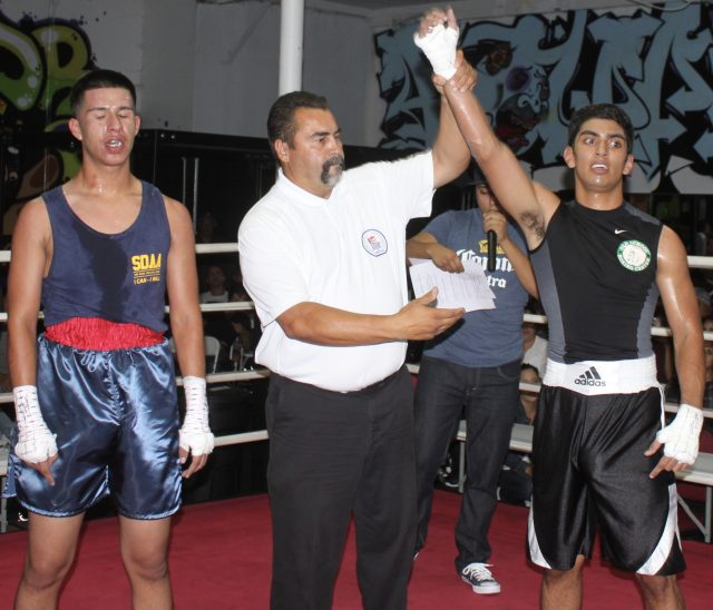 At the conclusion of Bout #2, we see referee Hondo Fontane raising the arm of the victorious Eric Villanueva after earning the decision victory over Jonathan Rodriguez.