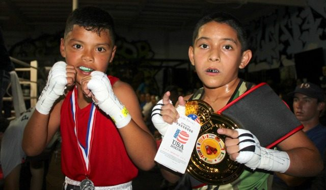 After both boxers have been seen by the official fight doctor, they graciously posed for one last photo.