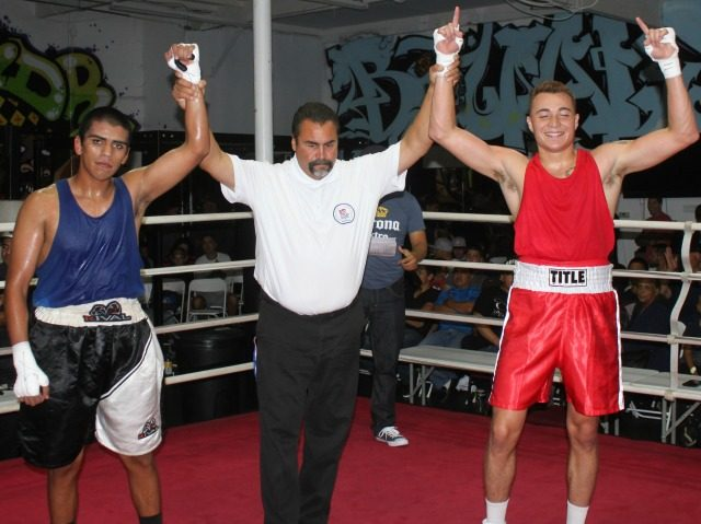 At the conclusion of Bout #5, we see referee Hondo Fontane raising the arms of the two combatants Anthiony Franco (r) and Joshua Rivera (l).
