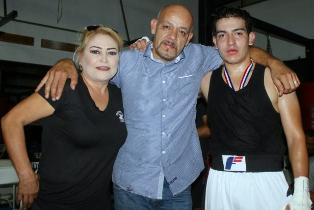 At the conclusion of Bout #1, Edgardo Garcia is joined by his proud parents.