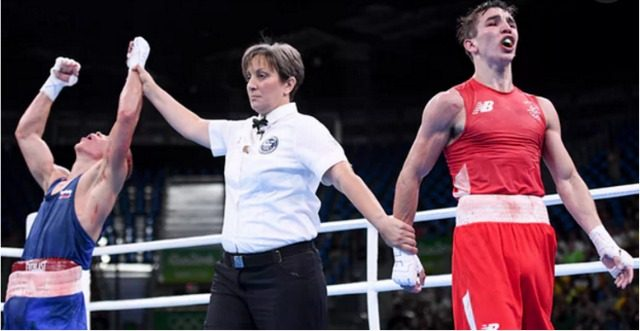 In the photo, we see Vladimir Nikitin (l) of Russia being declared the winner over Michael Conlan of Ireland. Soon after, Conlan, the Irish world champion started accusing the officials of cheating. Hmm!