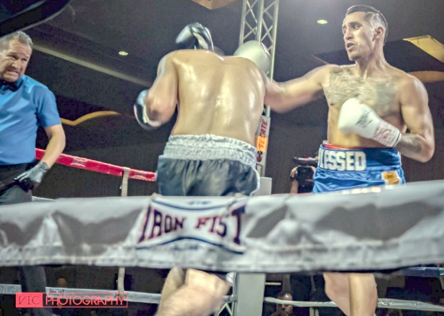Even the referee gringes as he sees Valdovinos unload this hard right cross to the head of his opponent in Bout #. All photos: Victor Morales.