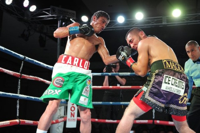 On Friday night we see Carlos Carlson (l) landing a solid left uppercut to the side of head. his opponent