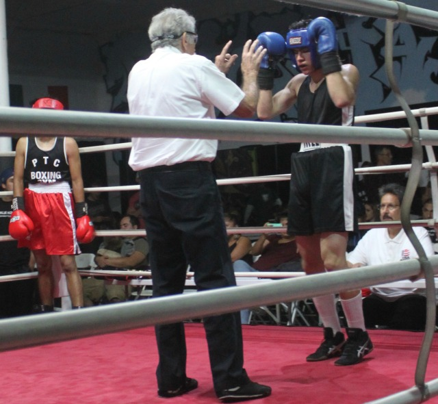 In this photo we see referee Will White issuing Santiago Galvez a standing 8-count.