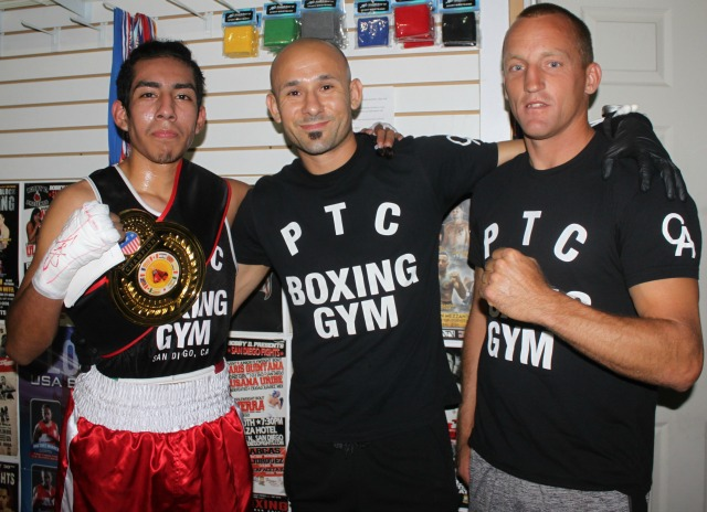 At the conclusion of Bout #5, Christian martinez is joined by coach Eddie Roa and stablemate