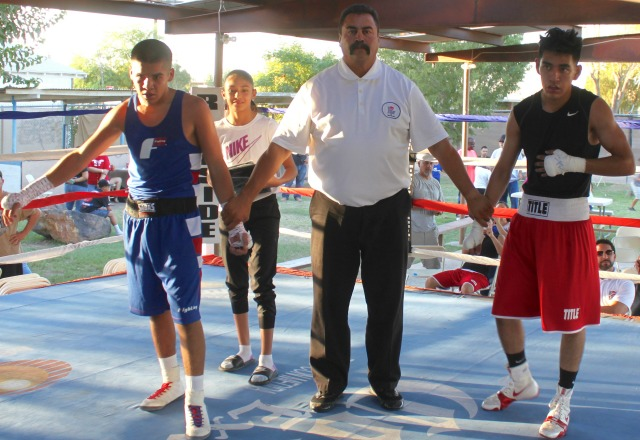 at the conclusion of the Jose Cordero versus Rene Martinez (left) bout, the boxers await the judges decision.