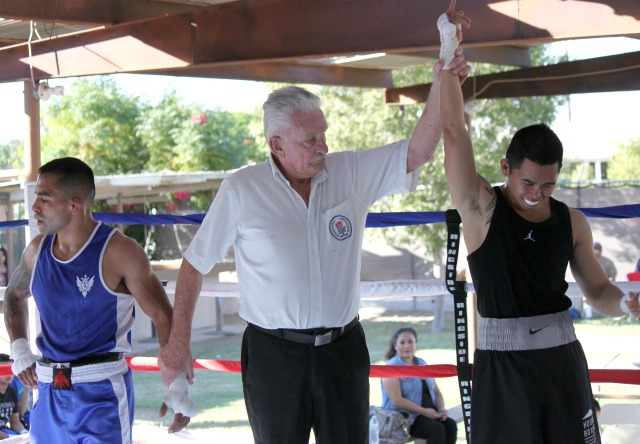 Bout #1: At the end of this great match it was Nico Marchan (r) being awarded the hard fought victory.