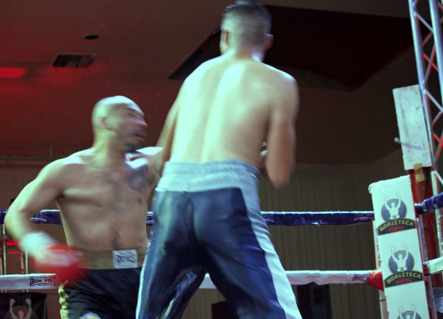In this photo you can see Escalante getting smacked by a solid left hook.