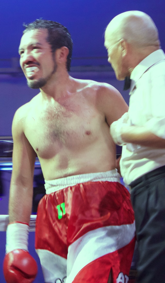 After Juan Sanchez Valencia got hit repeatedly in the face by Adrian Gutierrez, referee Juan Manuel Morales Lee made the decision to stop the bout and save Valencia from any serious harm.