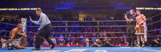 In this photo we see Danny Garcia awaiting the stoppage of the fallen Samuel Vargas.